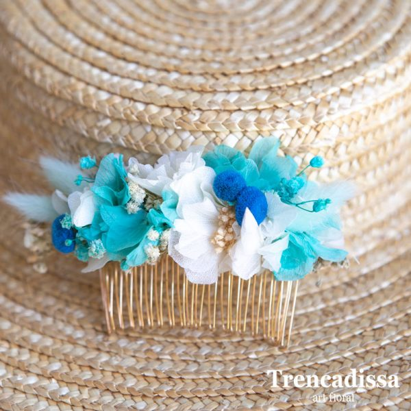 Peineta con flor seca y preservada en tonos azules y blancos