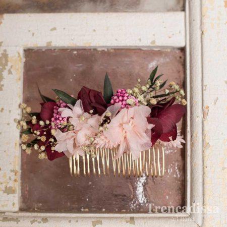 Peineta floral preservada en tonos rosados y granates